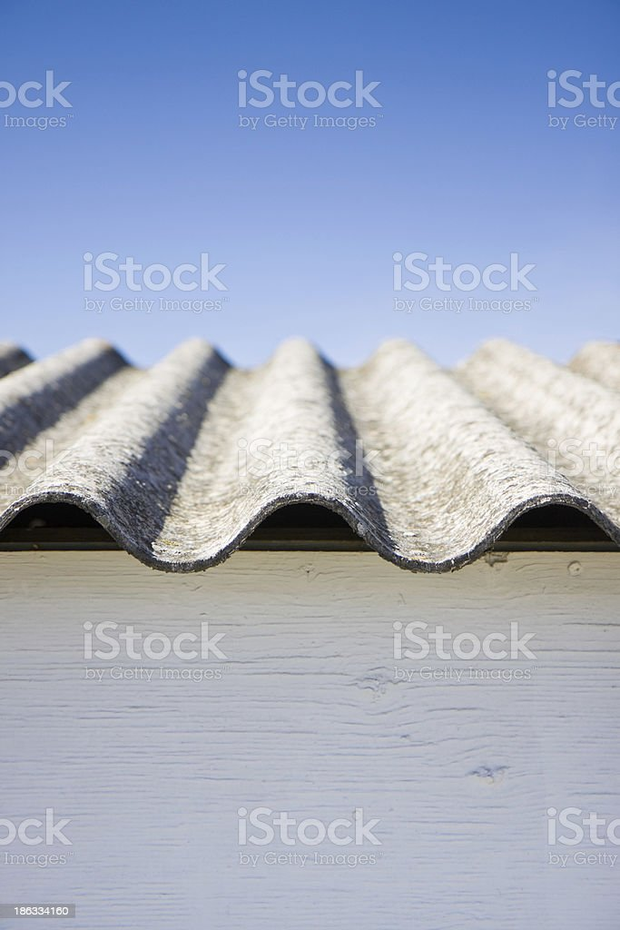Closeup of asbestos style roof against blue sky royalty-free stock photo