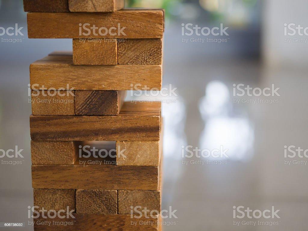 Closeup of asian kid's hand playing wood blocks stack games stock photo