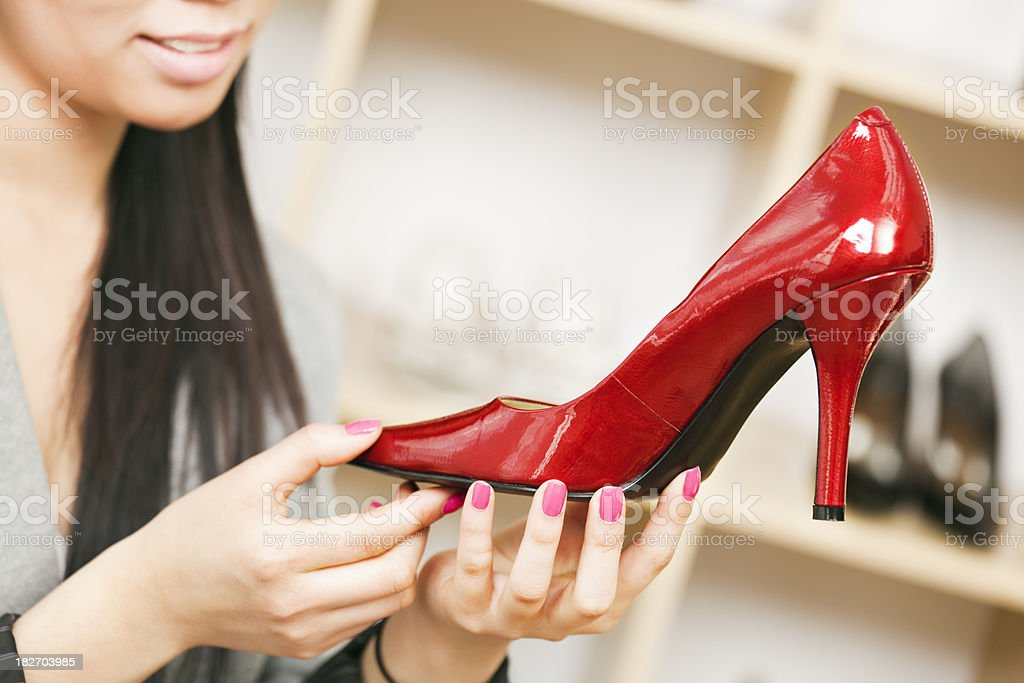 Close-up of Asian Woman Shopper, Red Shoe in Department Store royalty-free stock photo