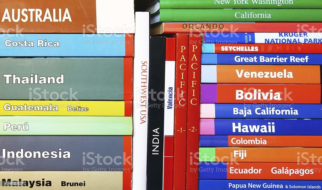 Close-up of assorted travel books for different countries stock photo