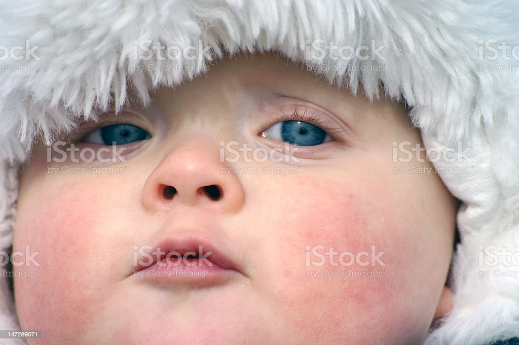 Close-up of baby boy with blue eyes stock photo