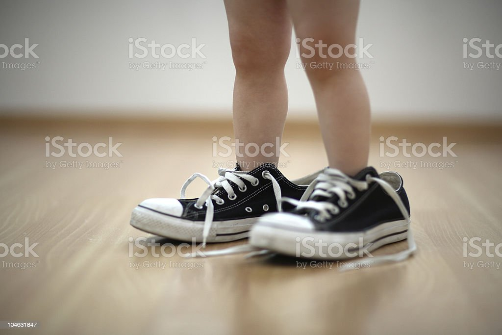 Close-up of baby wearing black sneakers royalty-free stock photo