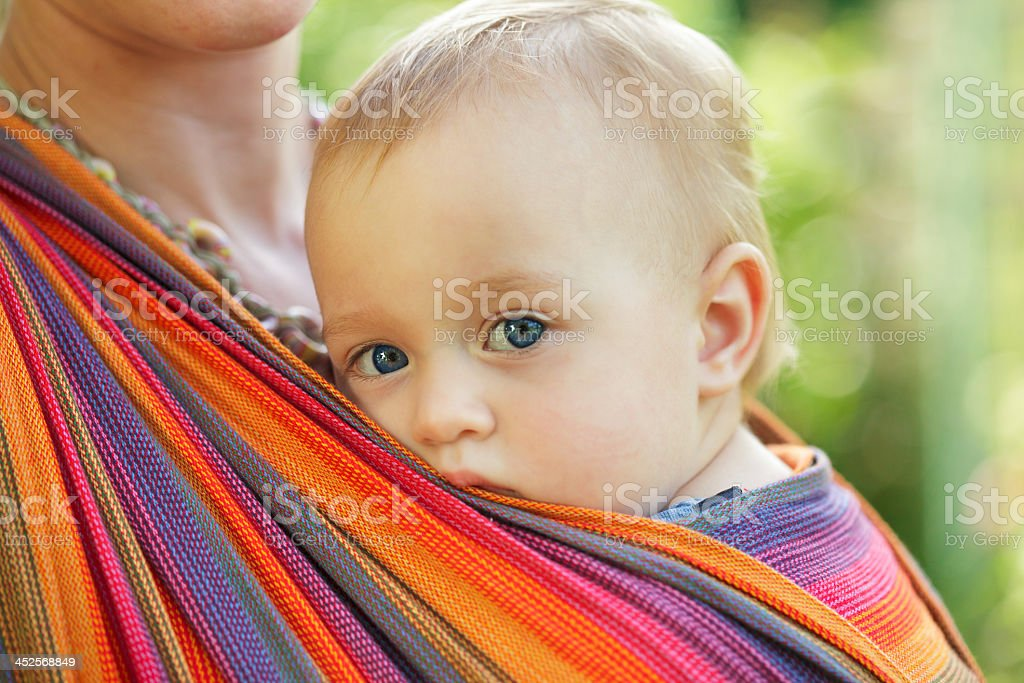 Close-up of baby's face while traveling in a sling stock photo