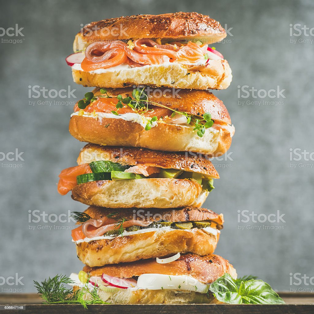 Close-up of Bagels heap with smoked salmon, eggs, vegetables stock photo