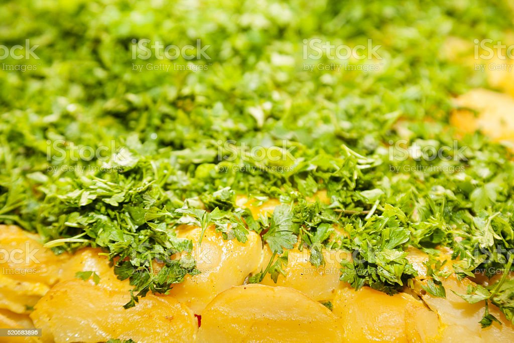 Closeup of baked potatoes with green parsley stock photo