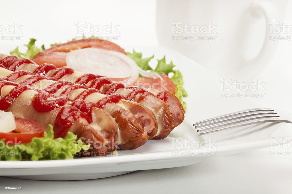 Closeup of baked sausage witch cheese stock photo