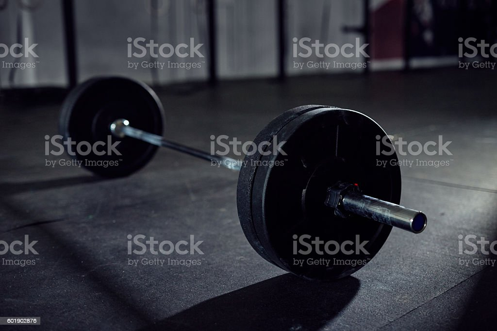 Closeup of barbell on gym floor stock photo
