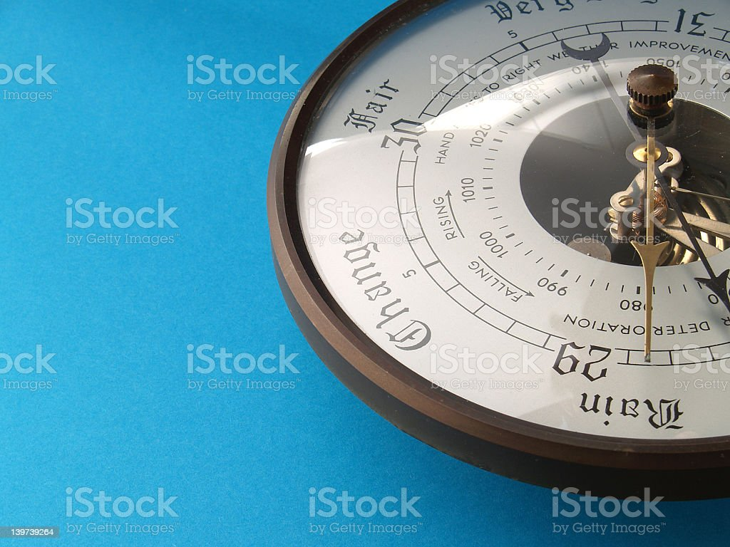 Close-up of barometer on blue background stock photo
