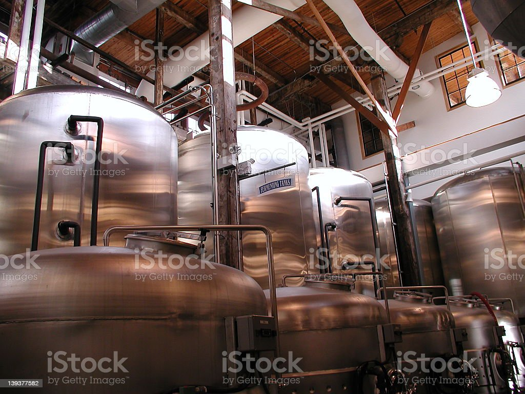 A close-up of barrels in a brewery stock photo
