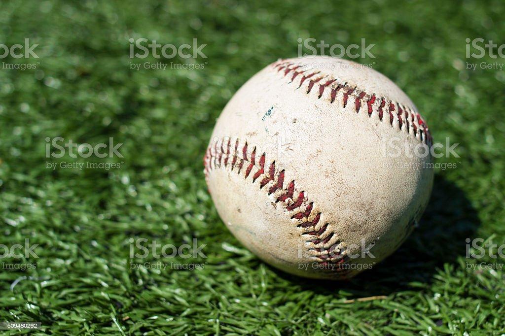 Close-up of baseball on green turf stock photo