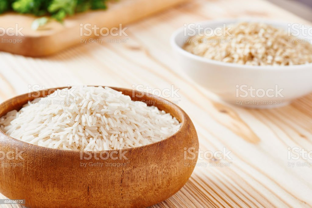 Close-up of basmati rice, brown rice in soft-focus stock photo