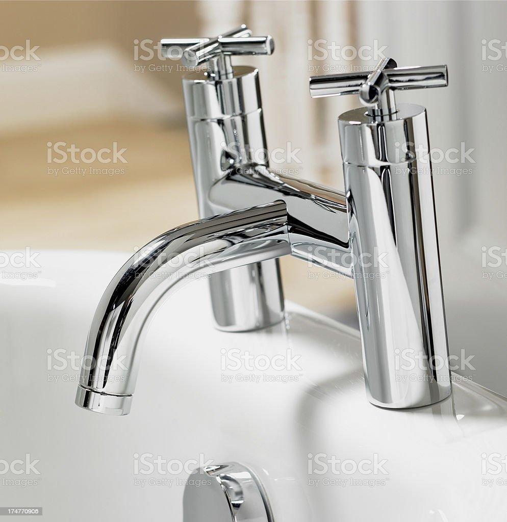 Closeup of bathroom faucet stock photo