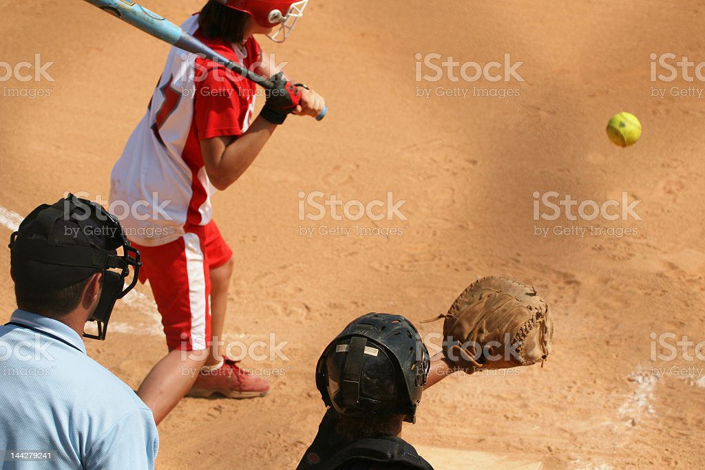 Close-up of batter, umpire, and catcher at a softball game royalty-free stock photo