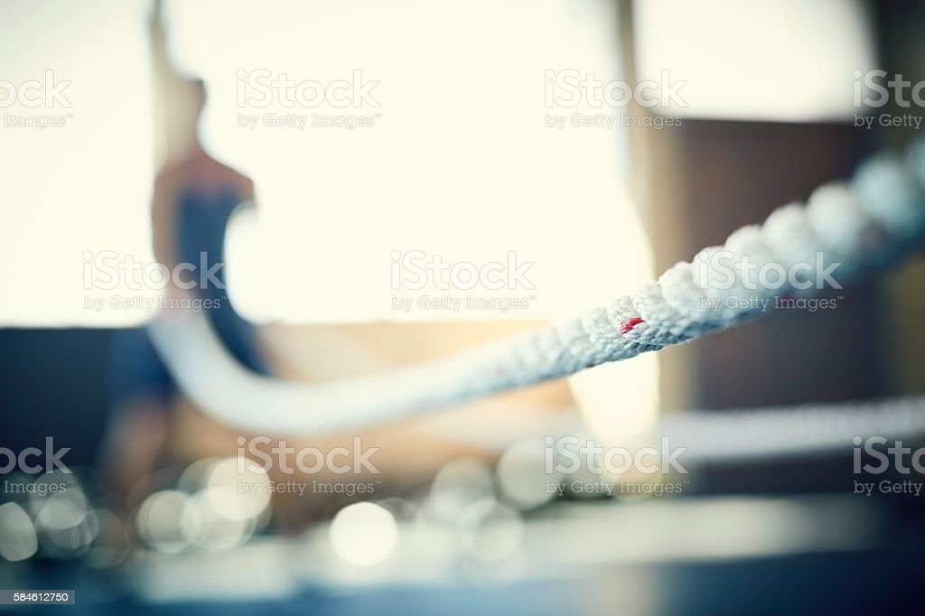 Close-up of battling rope in brightly lit gym stock photo