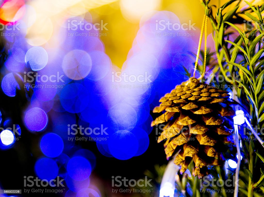 Closeup of bauble hanging on Christmas tree stock photo