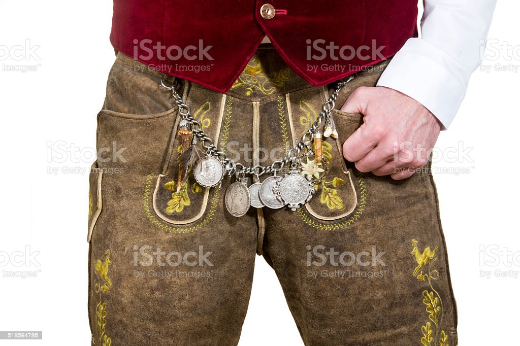 closeup of bavarian man wearing leather pants stock photo