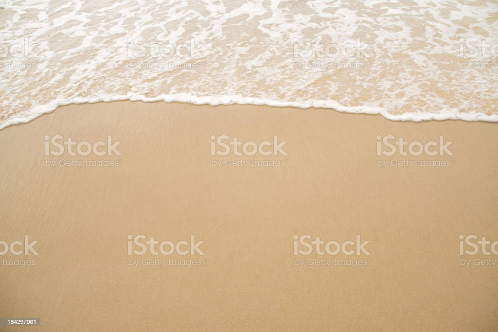 Close-up of beach coastline with receding waves royalty-free stock photo