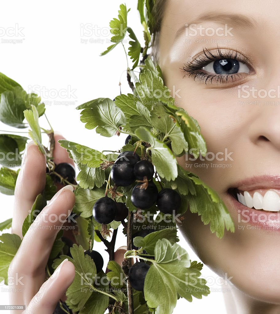 Close-up of beautiful face with currant royalty-free stock photo