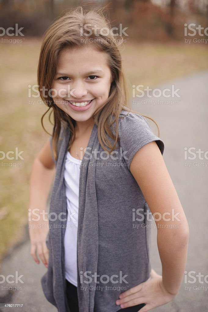 Closeup of Beautiful Girl Standing Outside With Hands on Hips royalty-free stock photo
