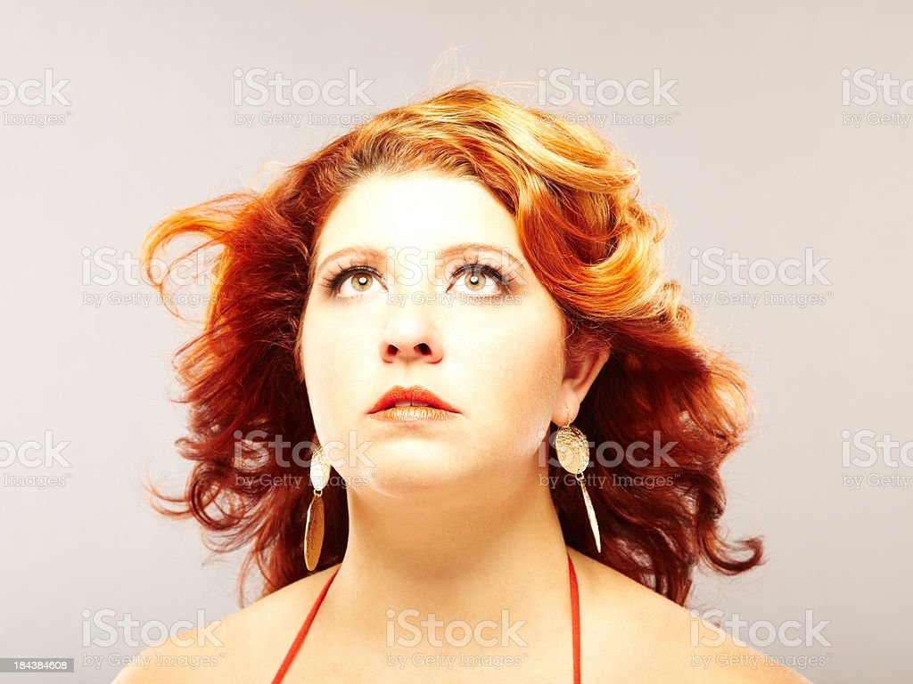 Close-up of beautiful plus size redhead woman looking up royalty-free stock photo