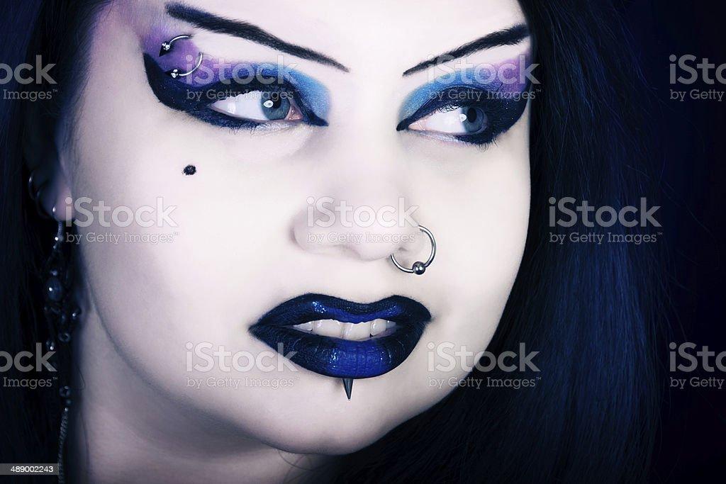 Closeup of beautiful Vampiress looking away. stock photo