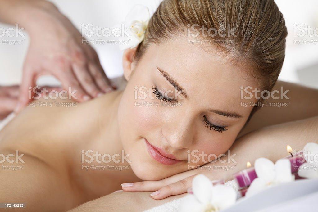 Close-up of beautiful woman enjoying masage at spa royalty-free stock photo