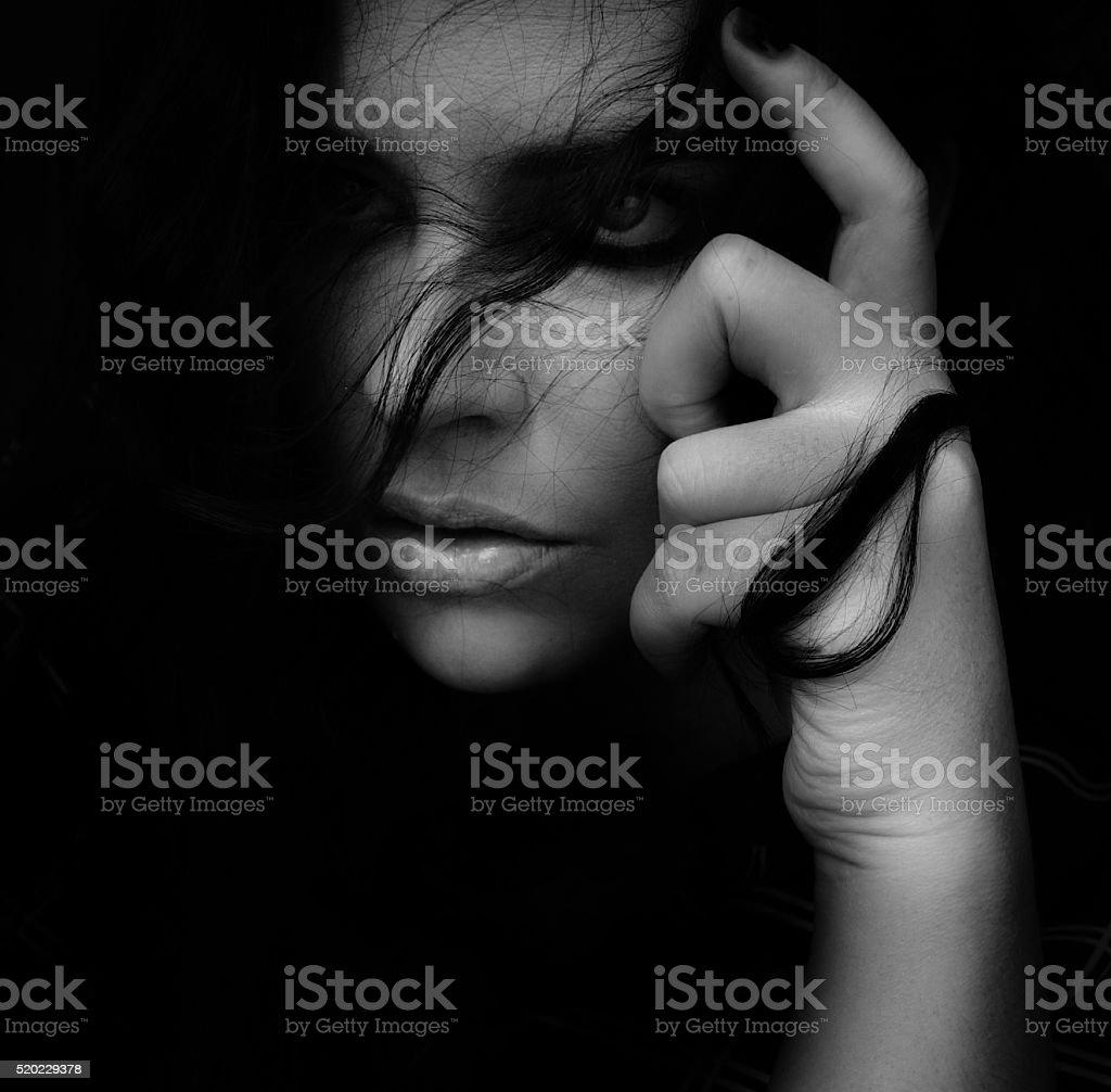 close-up of beautiful woman hair around hand stock photo