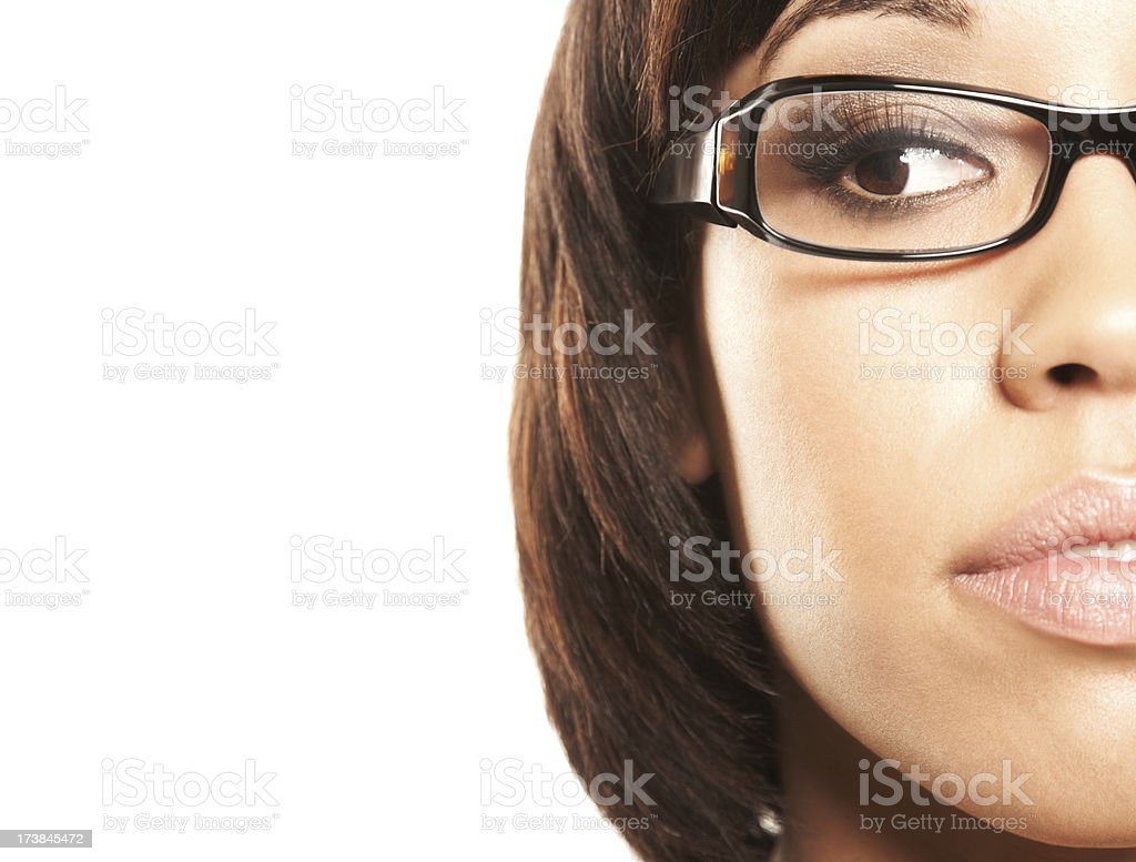 Close-up of beautiful woman in glasses looking at copy space royalty-free stock photo