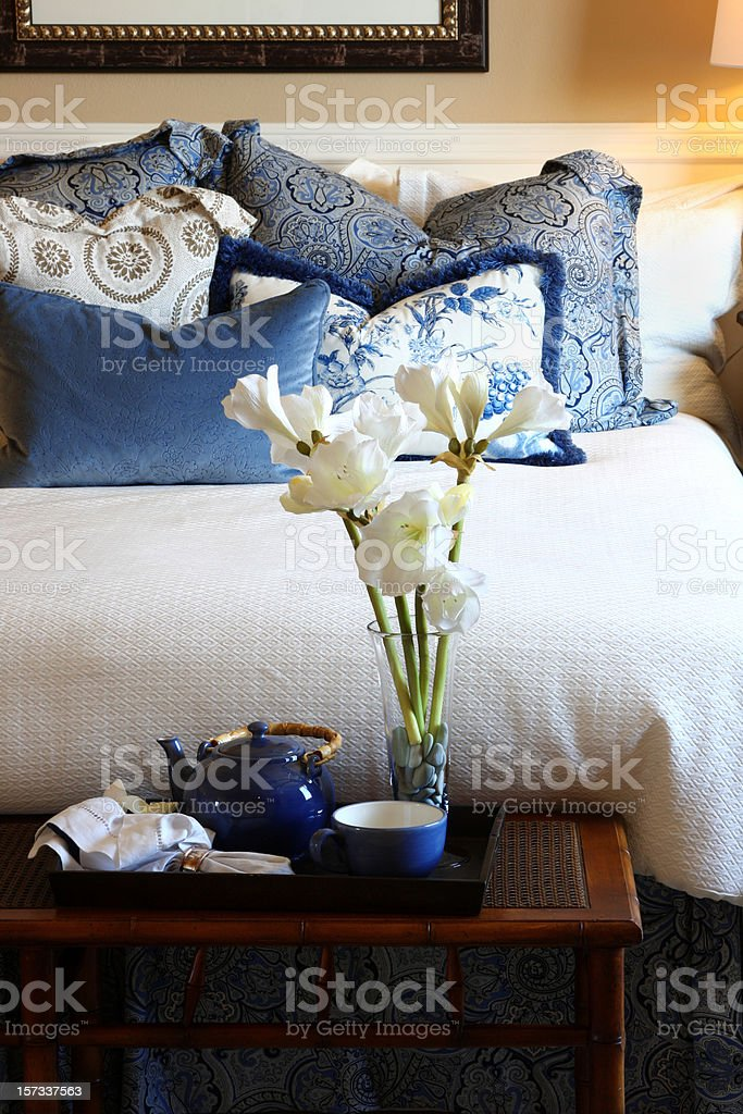 Closeup of bed and bedroom decor in blue and white stock photo