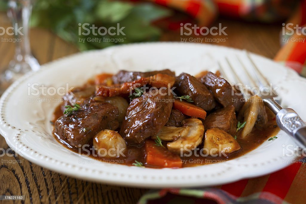 Close-up of Beef Bourguignon served on white plate stock photo