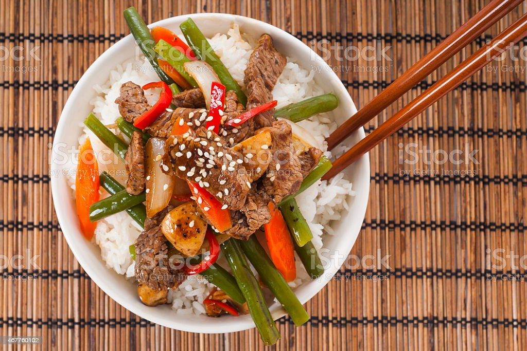 Close-up of beef stir fry on bamboo placemat stock photo