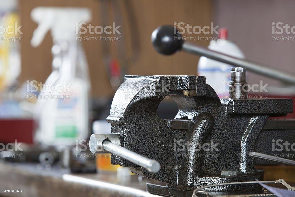 Closeup of bench vice at workroom stock photo