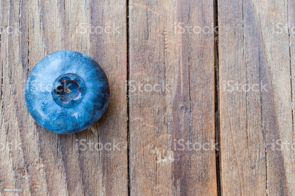 close-up of berries on a wooden background stock photo