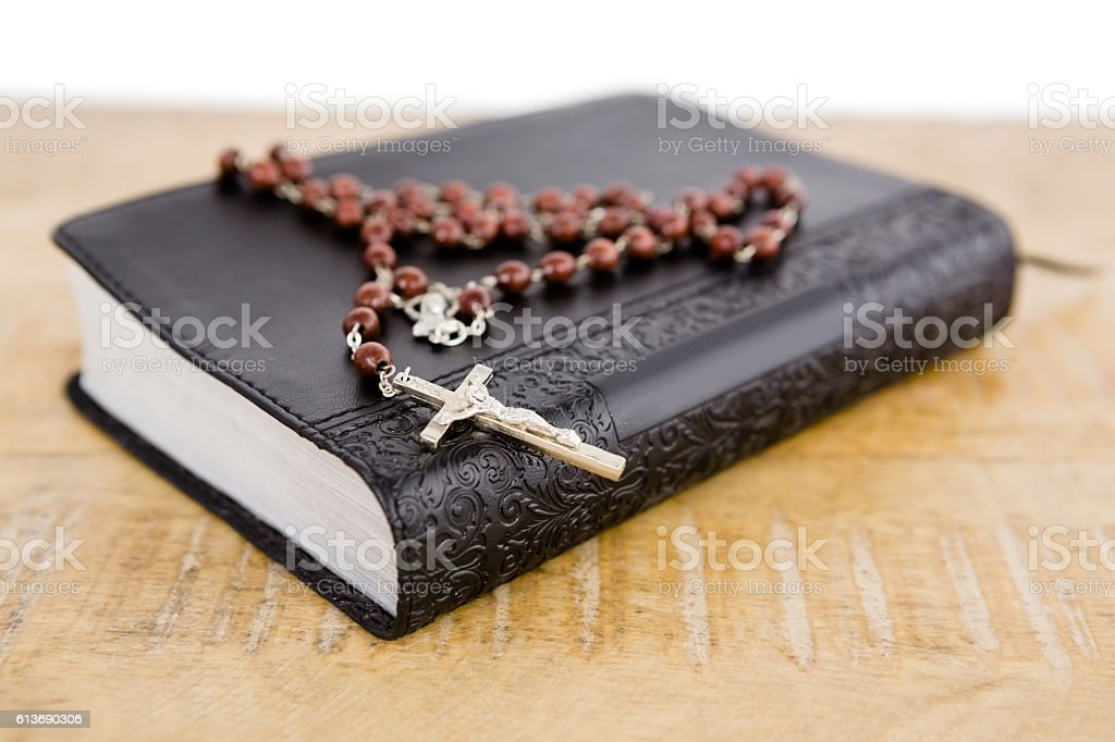 Close-up of bible and rosary beads stock photo