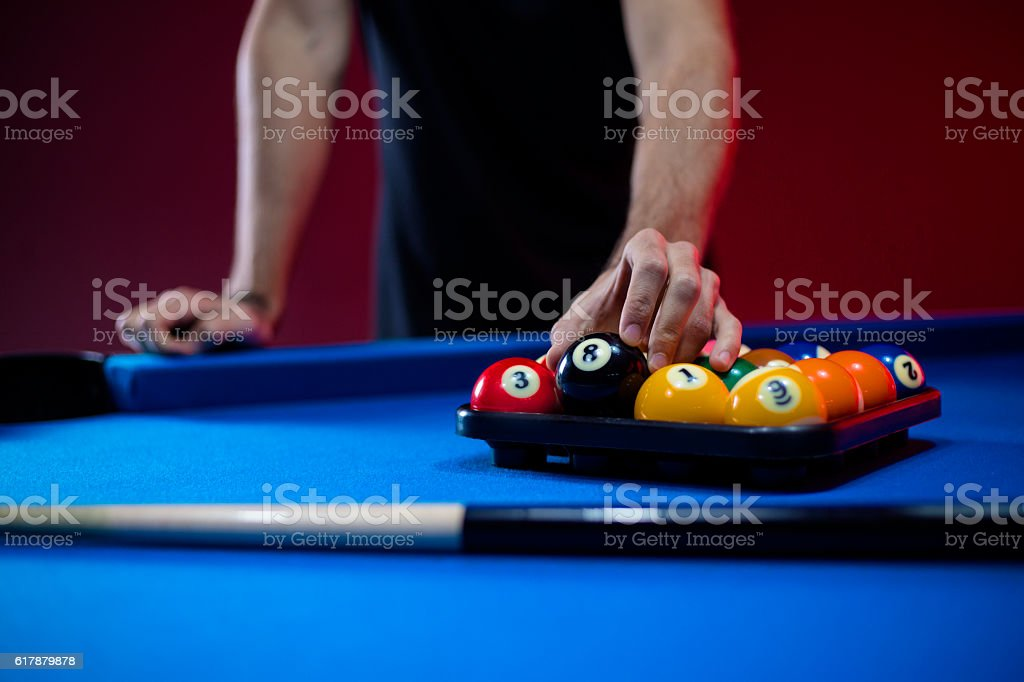 Close-up of billiard balls on a blue pool table stock photo