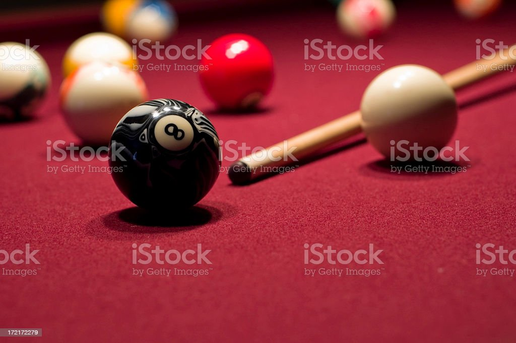 Close-up of billiards cue and eight ball stock photo