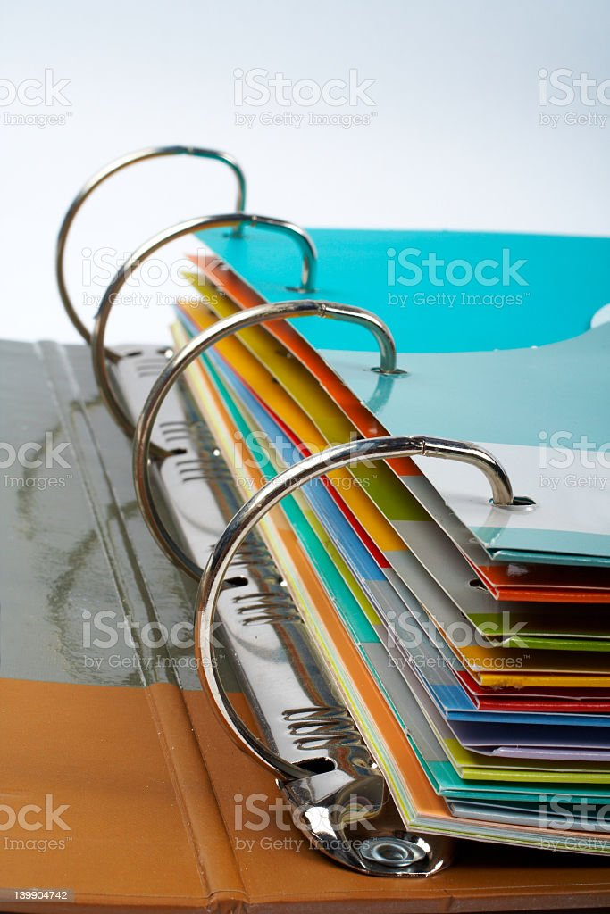Close-up of binder with stacked files stock photo
