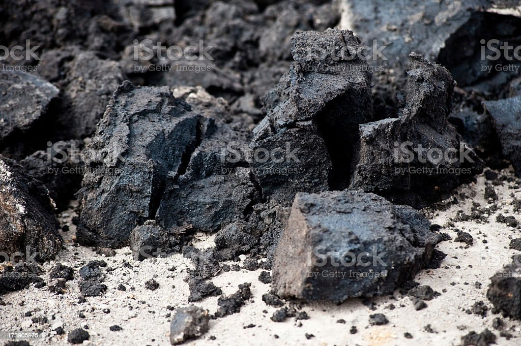 Closeup of black deposits of oil sands stock photo