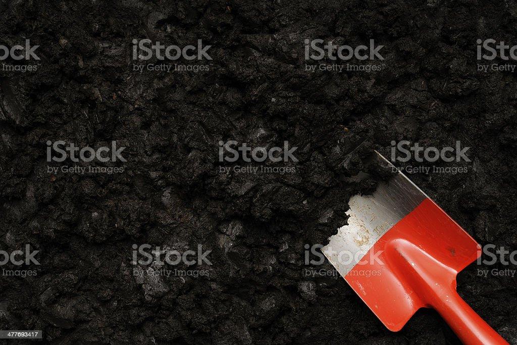 Close-up of black humus soil with shovel royalty-free stock photo