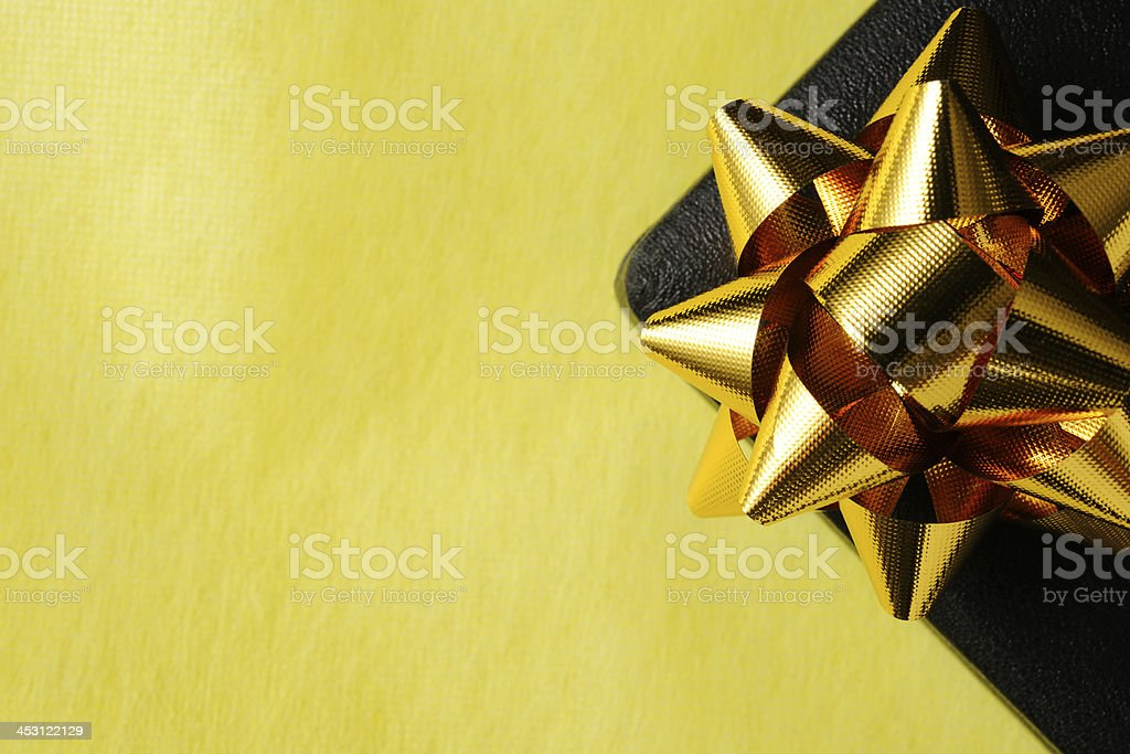 Close-up of black jewelry gift box with gold ribbon royalty-free stock photo