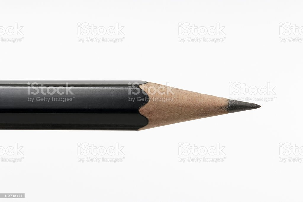 Close-up of black pencil against white background royalty-free stock photo