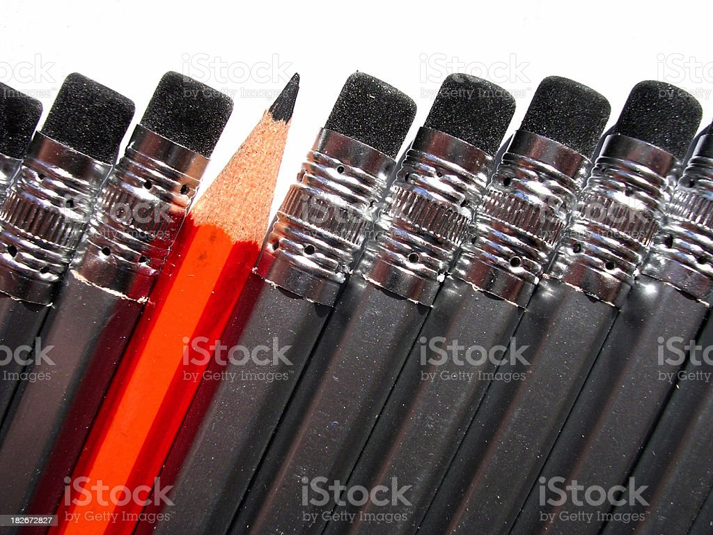 Close-up of black pencils with an upside down red pencil stock photo