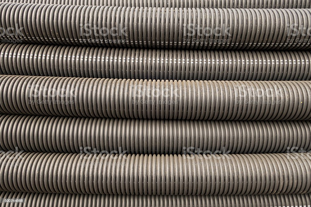 Closeup of black plastic pipes with diminishing perspective. stock photo