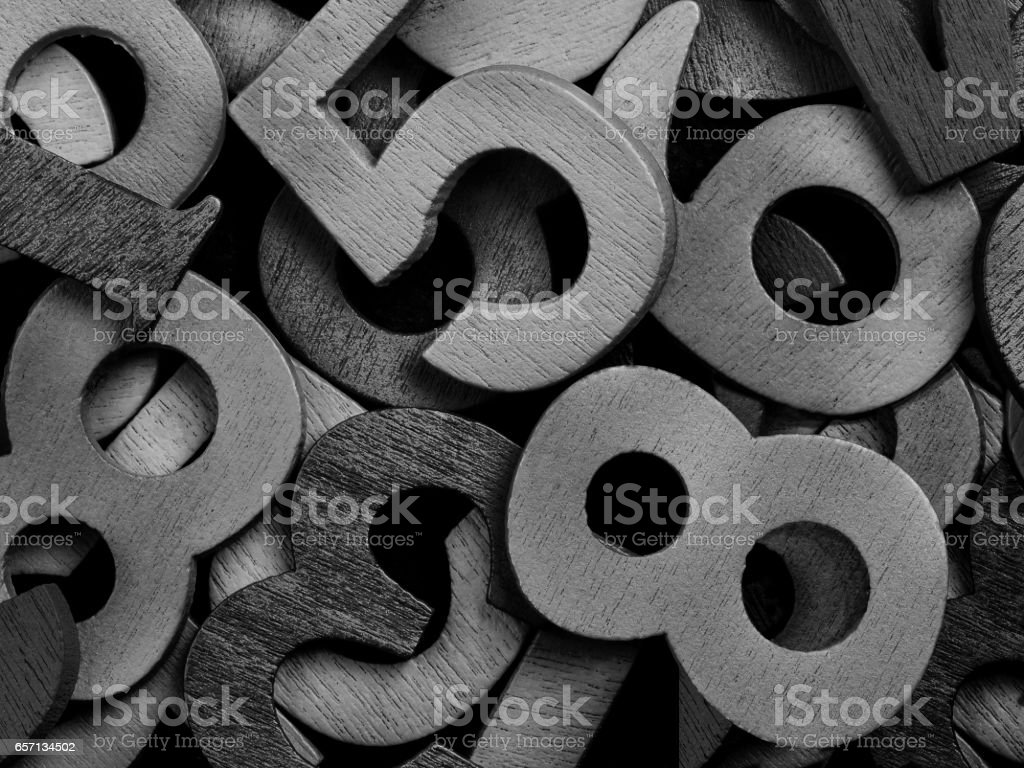 Close-up of black wooden numerals stock photo