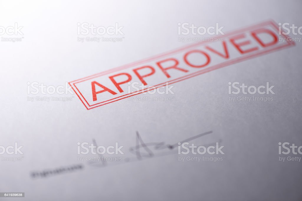 Close-up of blank contract form with approved stamped stock photo