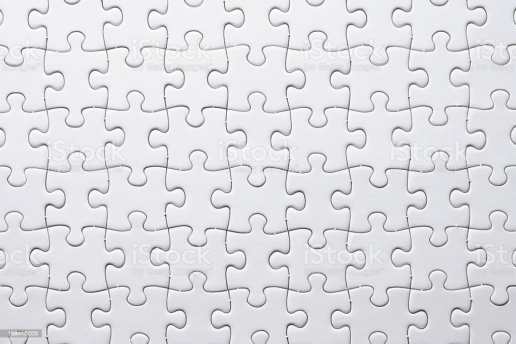 Close-up of blank white jigsaw puzzle texture background stock photo