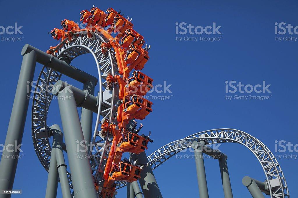 Close-up of blood-pumping orange ride at an amusement park royalty-free stock photo