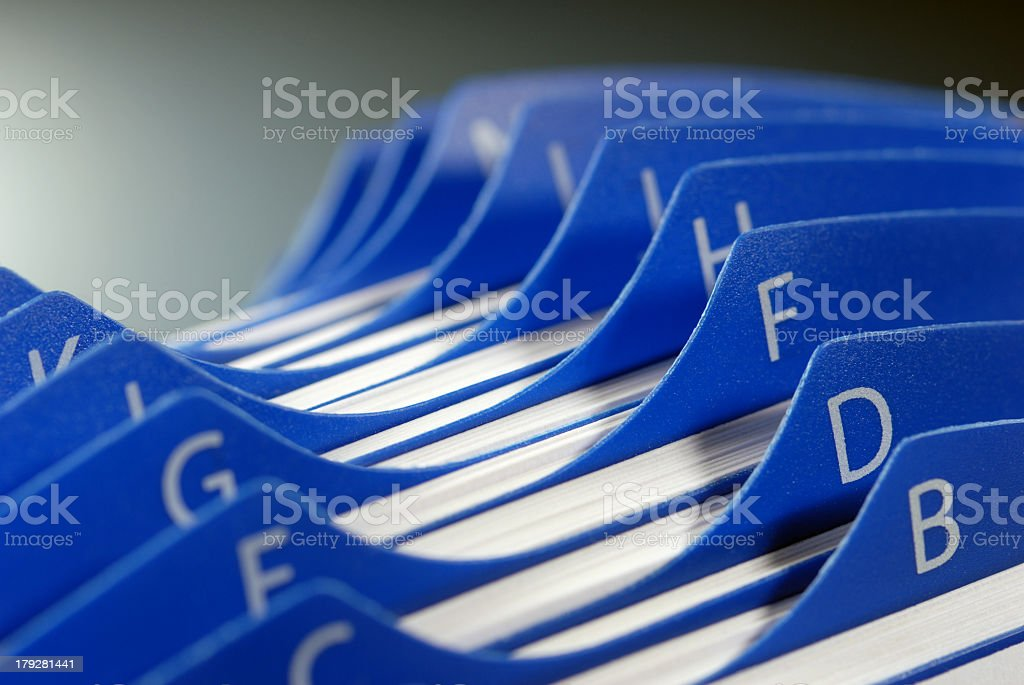 Close-up of blue business card organizer stock photo