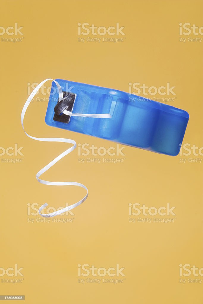 Close-up of blue dental floss dispenser royalty-free stock photo