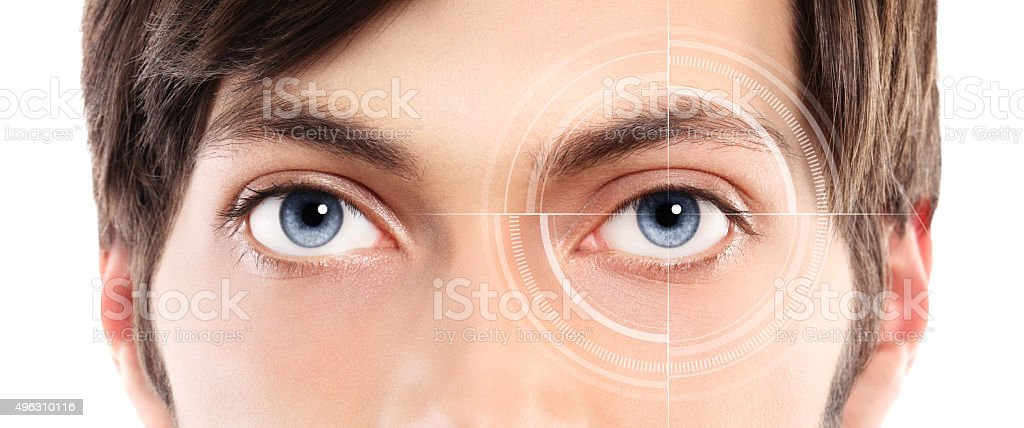 Closeup of blue eyes from young man and laser hologram stock photo